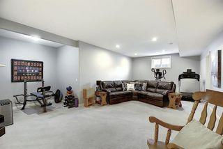 Photo 34: 45 Cougarstone Manor SW in Calgary: Cougar Ridge Detached for sale : MLS®# A1052755