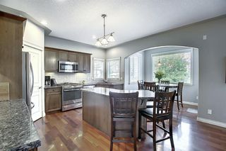 Photo 8: 45 Cougarstone Manor SW in Calgary: Cougar Ridge Detached for sale : MLS®# A1052755