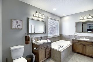 Photo 27: 45 Cougarstone Manor SW in Calgary: Cougar Ridge Detached for sale : MLS®# A1052755