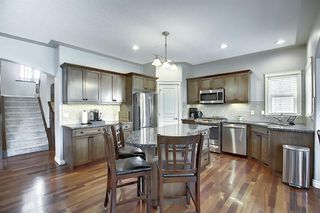 Photo 5: 45 Cougarstone Manor SW in Calgary: Cougar Ridge Detached for sale : MLS®# A1052755
