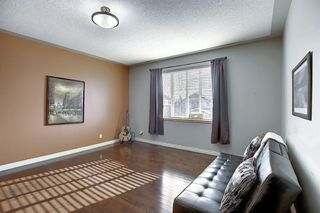 Photo 22: 45 Cougarstone Manor SW in Calgary: Cougar Ridge Detached for sale : MLS®# A1052755