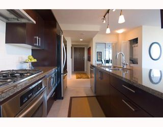 "Photo 8: 906 1650 W 7TH Avenue in Vancouver: Fairview VW Condo for sale in ""VIRTU"" (Vancouver West)  : MLS®# V748830"