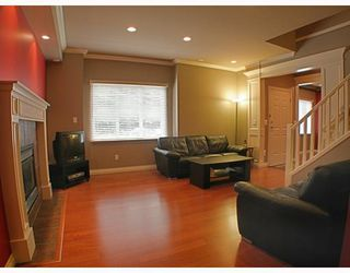 Photo 2: 7715 MCCARTHY Court in Burnaby: Burnaby Lake House for sale (Burnaby South)  : MLS®# V771957
