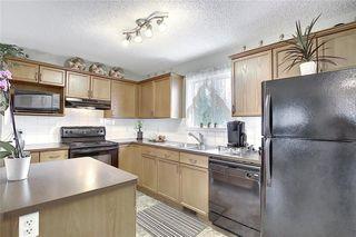 Photo 7: 120 EVERGLEN Road SW in Calgary: Evergreen Detached for sale : MLS®# C4305496