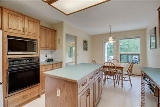 Photo 9: 104 Sunset Way: Priddis Greens Semi Detached for sale : MLS®# C4303646