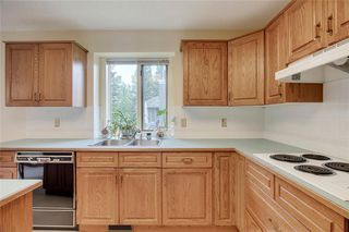 Photo 10: 104 Sunset Way: Priddis Greens Semi Detached for sale : MLS®# C4303646