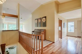 Photo 6: 104 Sunset Way: Priddis Greens Semi Detached for sale : MLS®# C4303646