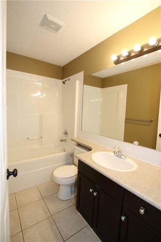 Photo 12: 402 2001 LUXSTONE Boulevard SW: Airdrie Row/Townhouse for sale : MLS®# C4284941