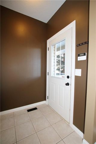 Photo 4: 402 2001 LUXSTONE Boulevard SW: Airdrie Row/Townhouse for sale : MLS®# C4284941