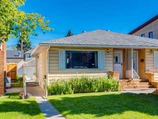 Photo 1: 120A 27 Avenue NE in Calgary: Tuxedo Park Semi Detached for sale : MLS®# A1018134