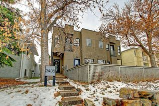 Main Photo: 1 2435 29 Street SW in Calgary: Killarney/Glengarry Row/Townhouse for sale : MLS®# A1059155