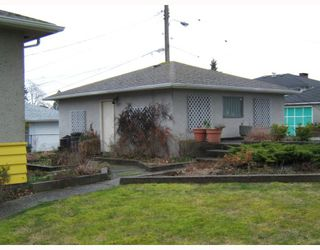 """Photo 8: 4770 DUCHESS Street in Vancouver: Collingwood VE House for sale in """"COLLINGWOOD"""" (Vancouver East)  : MLS®# V809813"""
