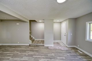 Photo 5: 328 FALTON Drive NE in Calgary: Falconridge Detached for sale : MLS®# C4301347