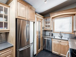 Photo 9: 2608 LIONEL Crescent SW in Calgary: Lakeview Detached for sale : MLS®# A1028717