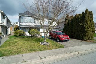 "Photo 1: 3311 HYDE PARK Place in Coquitlam: Park Ridge Estates House for sale in ""PARK RIDGE ESTATES"" : MLS®# R2473200"