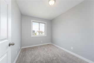 Photo 11: 116 FALMERE Way NE in Calgary: Falconridge Detached for sale : MLS®# A1043160