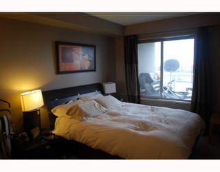 """Photo 7: 311 8420 JELLICOE Street in Vancouver: Fraserview VE Condo for sale in """"BOARDWALK"""" (Vancouver East)  : MLS®# V803299"""