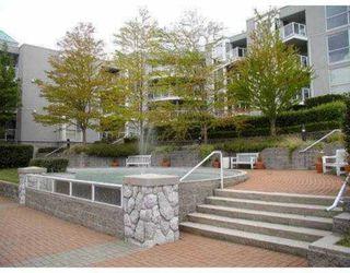 """Photo 1: 311 8420 JELLICOE Street in Vancouver: Fraserview VE Condo for sale in """"BOARDWALK"""" (Vancouver East)  : MLS®# V803299"""