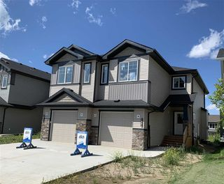 Photo 1: 8567 CUSHING Place in Edmonton: Zone 55 House Half Duplex for sale : MLS®# E4183569
