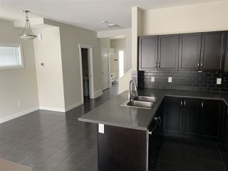 Photo 7: 9911 217 Street in Edmonton: Zone 58 House Half Duplex for sale : MLS®# E4186501