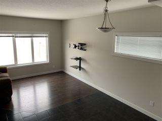 Photo 3: 9911 217 Street in Edmonton: Zone 58 House Half Duplex for sale : MLS®# E4186501