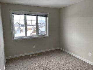 Photo 17: 9911 217 Street in Edmonton: Zone 58 House Half Duplex for sale : MLS®# E4186501