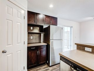 Photo 8: 82 Country Village Gate NE in Calgary: Country Hills Village Row/Townhouse for sale : MLS®# A1049770