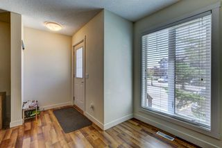 Photo 3: 504 2445 KINGSLAND Road SE: Airdrie Row/Townhouse for sale : MLS®# A1017254