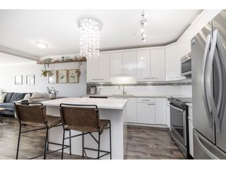 """Photo 2: 209 19228 64TH Avenue in Surrey: Clayton Condo for sale in """"Focal Point"""" (Cloverdale)  : MLS®# R2528445"""