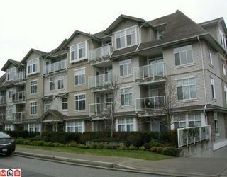 "Photo 1: 403 15323 17A Avenue in Surrey: King George Corridor Condo for sale in ""Semiahmoo Place"" (South Surrey White Rock)  : MLS®# F1000574"