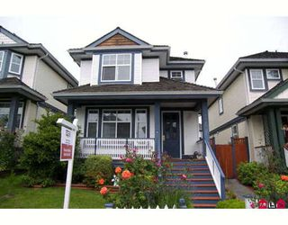 "Photo 1: 14865 57B Avenue in Surrey: Sullivan Station House for sale in ""Panorama Village"" : MLS®# F2818950"