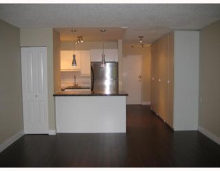 """Photo 2: 217 1545 E 2ND Avenue in Vancouver: Grandview VE Condo for sale in """"TALISHAN WOODS"""" (Vancouver East)  : MLS®# V725849"""