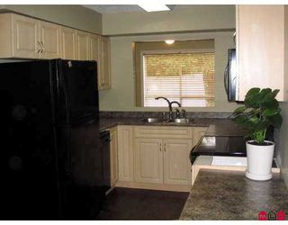 "Photo 1: 19860 56TH Ave in Langley: Langley City Townhouse for sale in ""ROSE COURT"" : MLS®# F2626080"