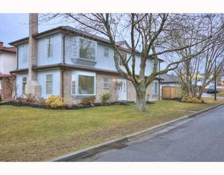 Photo 1: 1321 E 53RD Avenue in Vancouver: South Vancouver House for sale (Vancouver East)  : MLS®# V754796