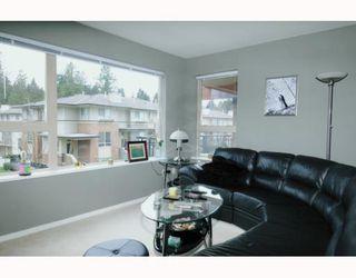 Photo 2: 211 200 KLAHANIE Drive in Port Moody: Port Moody Centre Condo for sale : MLS®# V805277