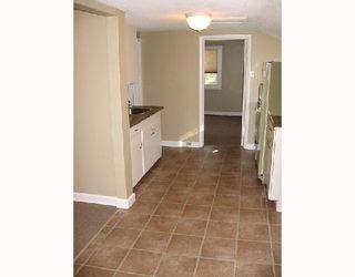Photo 5: 245 BERTRAND Street in WINNIPEG: St Boniface Duplex for sale (South East Winnipeg)  : MLS®# 2716492