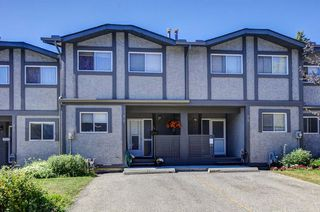Main Photo: 74 7172 COACH HILL Road SW in Calgary: Coach Hill Row/Townhouse for sale : MLS®# A1021211