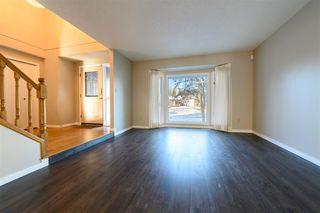 Photo 3: 735 WHEELER Road W in Edmonton: Zone 22 House for sale : MLS®# E4180457