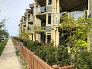 "Photo 1: 113 5160 DAVIS BAY Road in Sechelt: Sechelt District Condo for sale in ""THE WEST"" (Sunshine Coast)  : MLS®# R2421160"