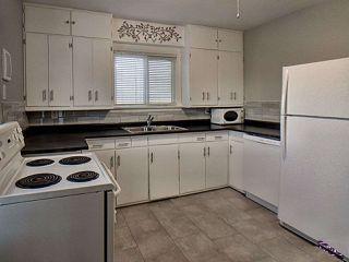Photo 4: 11613 81 Street in Edmonton: Zone 05 House for sale : MLS®# E4184038