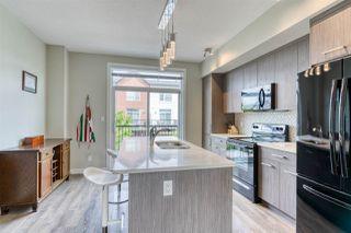Photo 2: 98 2560 Pegasus Boulevard NW in Edmonton: Zone 27 Townhouse for sale : MLS®# E4204693