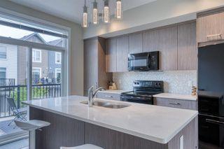 Photo 3: 98 2560 Pegasus Boulevard NW in Edmonton: Zone 27 Townhouse for sale : MLS®# E4204693