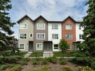 Photo 1: 98 2560 Pegasus Boulevard NW in Edmonton: Zone 27 Townhouse for sale : MLS®# E4204693