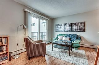 Photo 3: 204 823 1 Avenue NW in Calgary: Sunnyside Apartment for sale : MLS®# C4273040