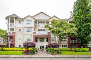 "Photo 1: 410 8068 120A Street in Surrey: Queen Mary Park Surrey Condo for sale in ""Melrose Place"" : MLS®# R2464731"