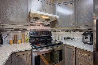 "Photo 13: 410 8068 120A Street in Surrey: Queen Mary Park Surrey Condo for sale in ""Melrose Place"" : MLS®# R2464731"