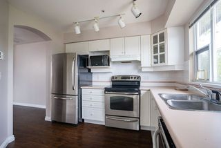 "Photo 9: 304 20120 56 Avenue in Langley: Langley City Condo for sale in ""Blackberry Lane 1"" : MLS®# R2467299"