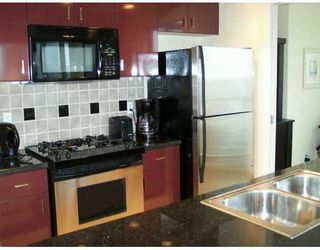 """Photo 4: 1033 MARINASIDE Crescent in Vancouver: False Creek North Condo for sale in """"QUAYWEST"""" (Vancouver West)  : MLS®# V625851"""