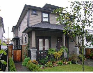 Photo 1: 2171 CHARLES Street in Vancouver: Grandview VE House 1/2 Duplex for sale (Vancouver East)  : MLS®# V742808