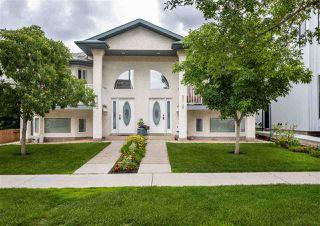 Photo 1: 8748-8752 77 Avenue in Edmonton: Zone 17 House Duplex for sale : MLS®# E4203341
